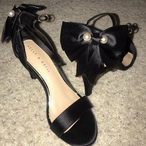 Black heels with bows on the back
